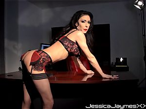 crazy dark haired Jessica Jaymes fingers her edible cootchie pie in her office