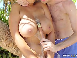 buxomy stunner Bridgette B analled in the garden