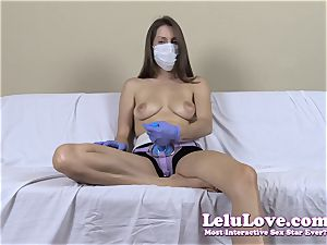stripped to the waist nymph with medical mask and strapon