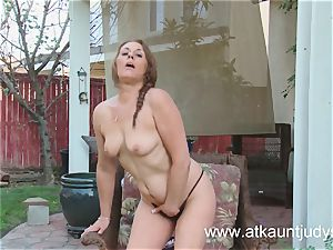 Cristine Ruby fingers her snatch outdoors.