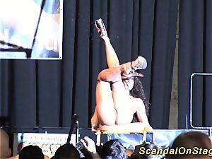 huge-chested lithe stripper on stage