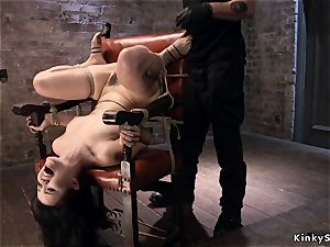 frog-tied asian in cord suspension upside down