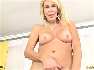 Mature blondie flashes off her vulva and tears up