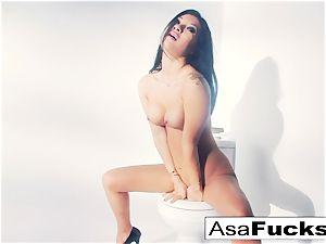 Asa Akira uses a faux hand to satisfy her vulva
