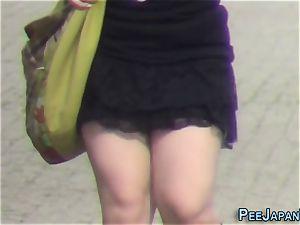japanese nubile urinates in public