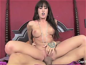 huge-titted Capri Cavanni humps on the couch