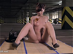 Jeny Smith unveiling her perfect figure in a parking garage