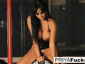 big-boobed Priya Rai rides the sybian at the undress club