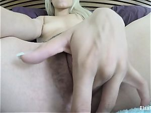 little honey Elsa Jean fingers her fur covered fuckbox